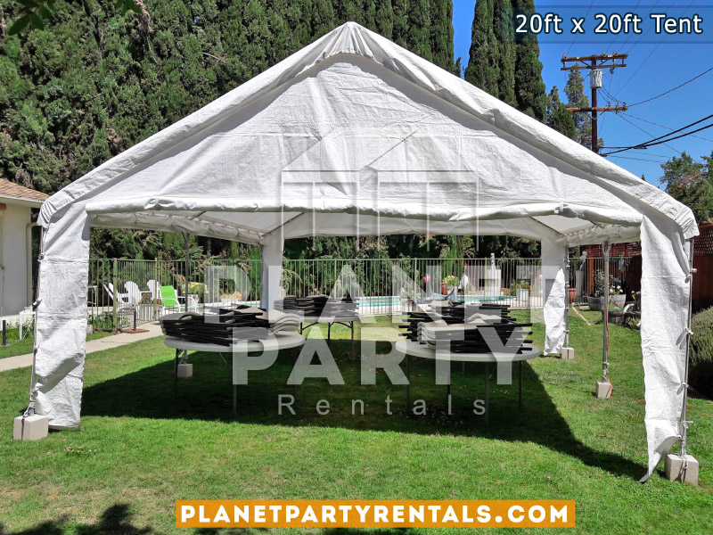 Party tent with round tables and chairs.