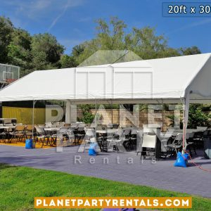 20x30 Tent on basketball court with plastic chairs and rectangular tables